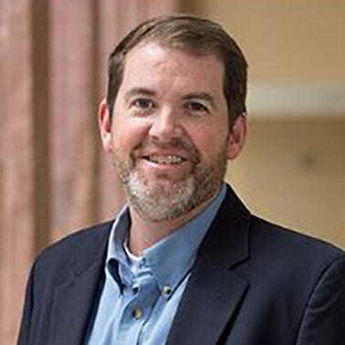 Dr. M. Travis Maynard